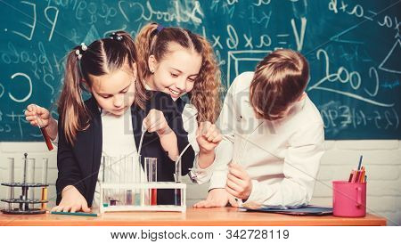 Happy Children. Chemistry Lesson. Little Kids Learning Chemistry. Students Doing Biology Experiments