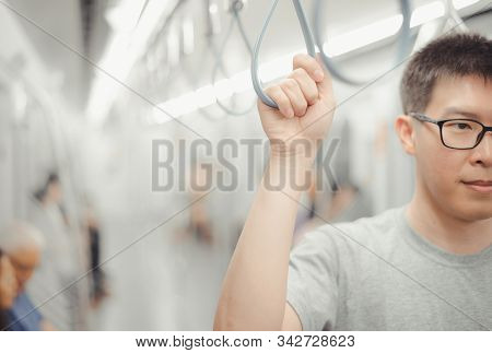 City Living Concept Male Hand Holding A Looped Handle In Urban Public Transportation
