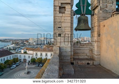 Bell In Cathedral Of Faro Se De Faro Is A Roman Catholic Cathedral, With A View Of The Town Of Faro