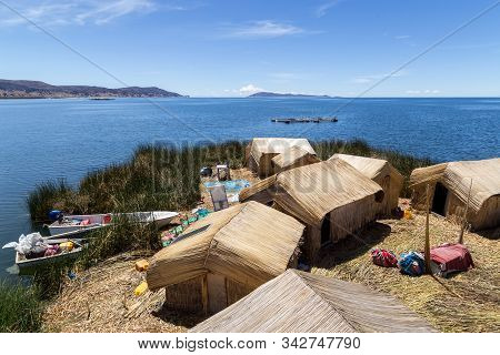 Titicaca Lake, Peru - October 14, 2015: Straw Huts And Boats On One Of The Titino Floating Islands O