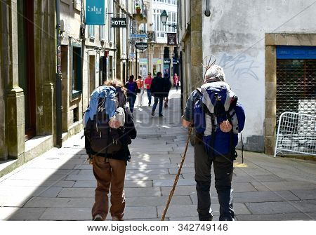 Santiago De Compostela, Spain. May 5, 2019. Pilgrims With Scallop Shell, Symbol Of Camino De Santiag