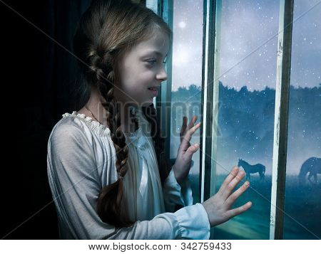 The Girl Looks Out The Window. Concept Of Childhood Memories, Dreams
