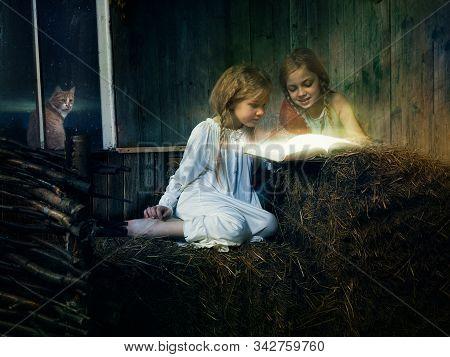 Children Read A Magic Book In Hayloft