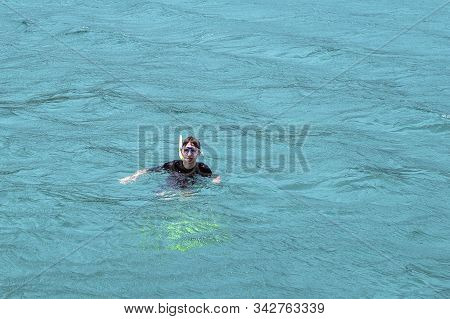 Yeppoon, Queensland, Australia - December 2019: A Young Caucasian Male Snorkeling In The Waters Over