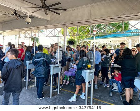Orlando,fl/usa-12/25/19: The Entrance To Seaworld Orlando Theme Park Where Employees Scan The Guests