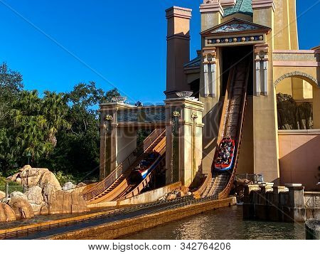 Orlando,fl/usa-12/25/19: People On The Journey To Atlantis Roller Coaster Water Ride At Seaworld Spe