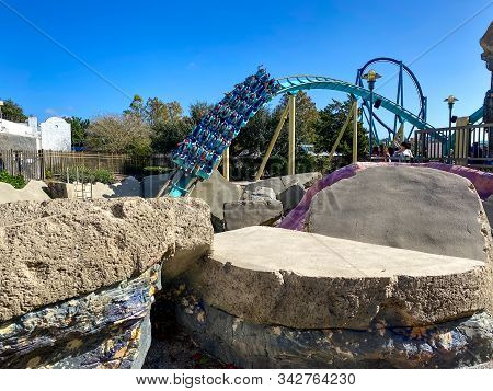 Orlando,fl/usa-12/25/19: People With Their Hands In The Air On The Kraken Unleashed Roller Coaster A