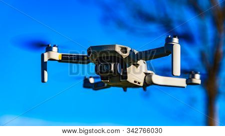 Graz, Austria: 02.01.2020 - Close Up Shoot Of A Dji Quadcopter Drone Mavic Mini 249g. Drone Flying A