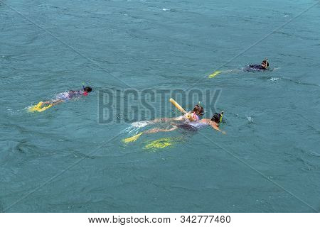 Yeppoon, Queensland, Australia - December 2019: Mother, Daughter And Sons Snorkeling In The Waters O