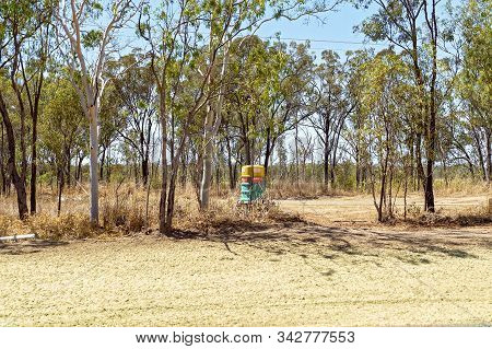 Rockhampton, Queensland, Australia - December 2019: A Mobile Toilet Out On Its Own In The Middle Of