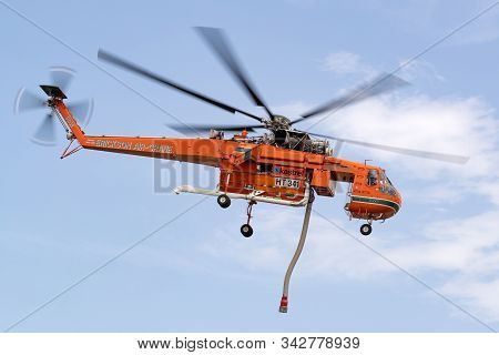 Bundoora, Australia - December 30, 2019: Fire Fighting Erickson Air Crane Helicopter Taking Off Afte