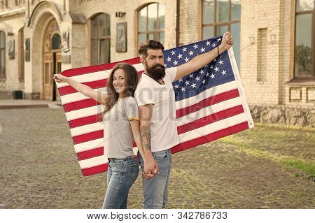 Celebrating Independence Day Together. Hipster And Sexy Woman Holding American Flag On Independence