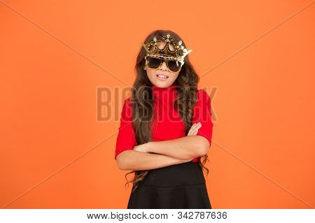 Awesome. Chic. Very Cool Girl. Little Child With Cool Look. Cool Kid Wear Prop Crown And Glasses. Co