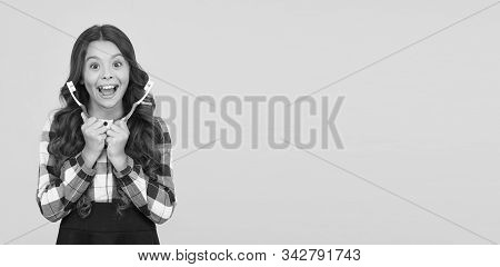 Spend Less On Dentist. Happy Girl Hold Brushes On Yellow Background. Little Child Smiling With Tooth