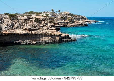 a view of the eastern coast of Cala Conta beach in Sant Josep de Sa Talaia, in Ibiza Island, Balearic Islands, Spain