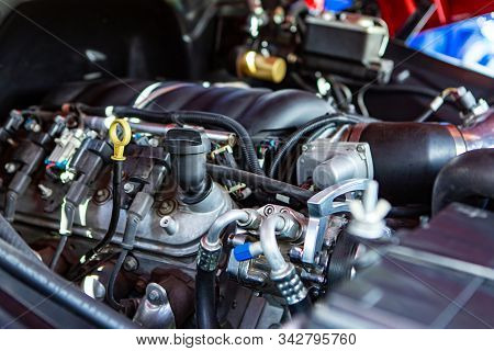 Car Under Hood Close Up, View On Modern Engine, Turbo, Tubes, Wires, Pipes, Engine Oil Level Indicat