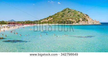 Sardinia. Italy - July 15, 2019: Sardinia. Italy. Cala Monte Turno Beach. Mountain Monte Turno on Background.