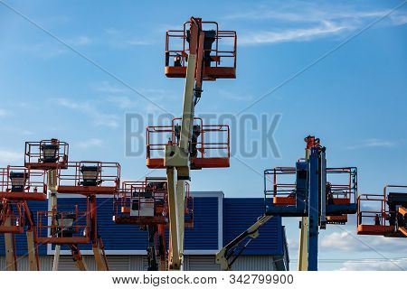 A Construction Industry Storage Unit And Yard Is Seen With A Group Of Mobile Elevating Work Platform