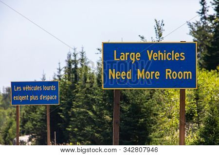 French And English Two Information Road Signs, Large Vehicles Need More Space. On The Canadian Rural