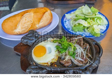 Delicious Sizzling Beef Steak Served With Bread And Salad