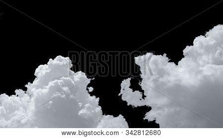 Pure White Cumulus Clouds On Black Background. Cloudscape Background. White Fluffy Clouds On Dark Ba