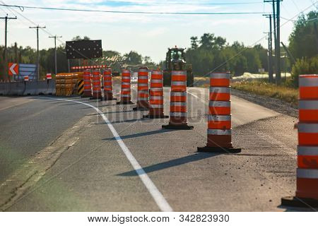 Temporary Road Cones And Lane Markings Create Leading Lines As Construction And Resurfacing Work Beg