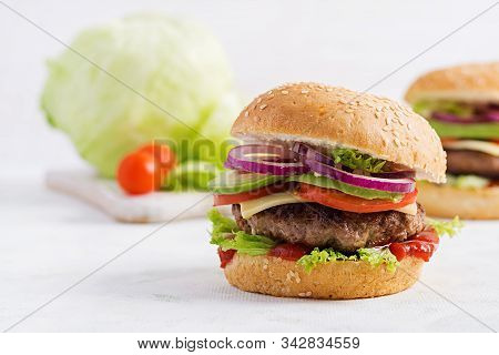 Big Sandwich - Hamburger Burger With Beef, Avocado, Tomato And Red Onions On Light Background. Ameri