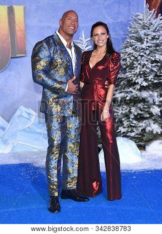 LOS ANGELES - DEC 09:  Dwayne Johnson and Lauren Hashian arrives for the ÔJumanji: The Next LevelÕ Los Angeles Premiere on December 09, 2019 in Hollywood, CA