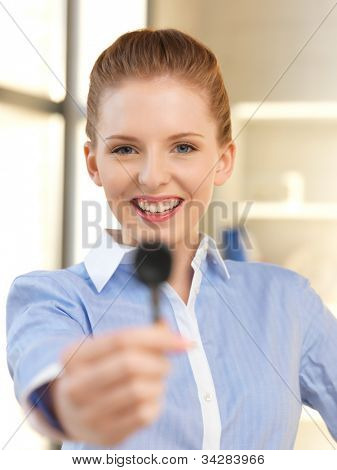 bright picture of happy woman with car key