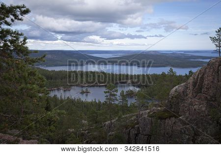 View From A Rock Close To The Sea. Islands And Water In The Background, Forests.