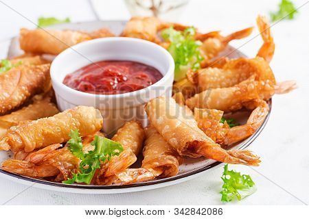 Shrimps With Ginger In Filo Pastry With Sweet And Sour Sauce. Thai Cuisine. Deep-fried Prawns.