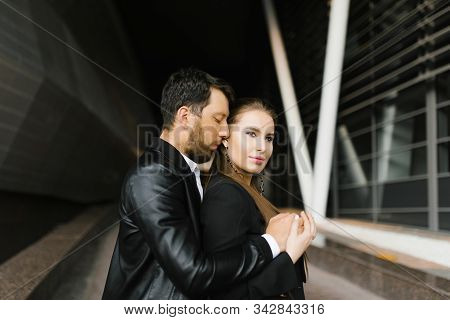 Office Prelude. A Young Cute Office Couple Is Busy Holding Each Other In A Tender Embrace