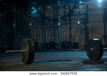 Barbell For Practicing In Weightlifting In Gym. Equipment For Strength And Power Training. Body Buil