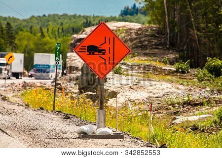 Truck Entrance On The Left Side Of The Road Ahead, Temporary Condition Road Signs, Warning Symbols O