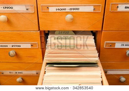 File Cabinet With Library Or Office. One Box Is Open. Database Concept. Library Card Or File Catalog