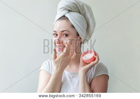 Minimal Beauty Woman Girl In Towel On Head Portrait Applying White Nourishing Mask Or Creme On Face