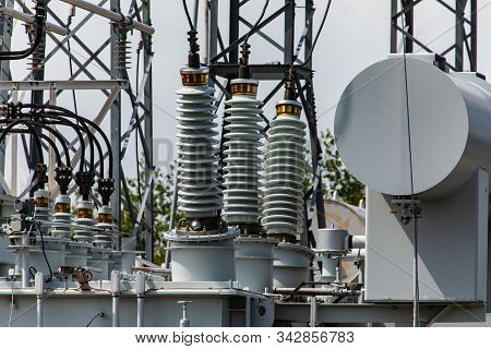 Three Phase Distribution Transformer In An Electrical Substation, Current Transformer, Close Up On T