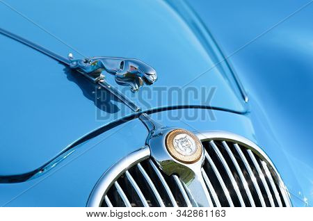 Rushmoor, Uk - April 19: Vehicle Badge And Front Grille Closeup On A Vintage Jaguar Automobile In Ru