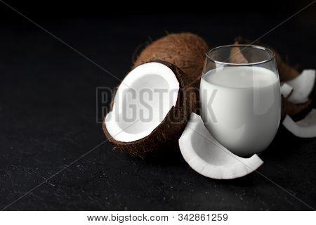 Fresh Coconut Milk In A Glass Against A Dark Background, Coconut Cosmetic Cream, Milkshake With Coco