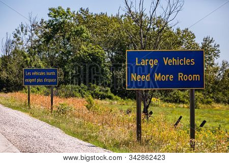 French, English Information Road Signs, Large Vehicles Need More Space. On Canadian Rural Country Ro