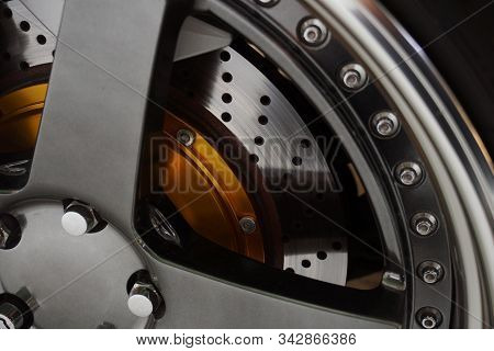 The Brake System Of A Sport Car,car Wheel - Close Up Of Rims From A Sports Car , Part Of Modern New