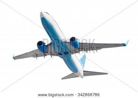 Flying Passenger Aircraft With Retracted Landing Gear Isolated On A White Background. Bottom View