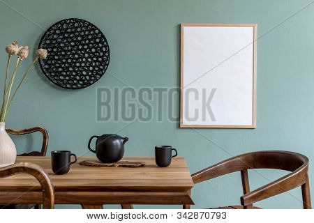 Stylish And Design Dining Room Interior With Mock Up Poster Frame, Wooden Table, Chairs, Teapot With