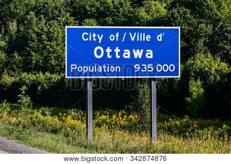 Ottawa City Entrance Information Road Blue Sign On The Roadside, Canadian Two Languages French And E