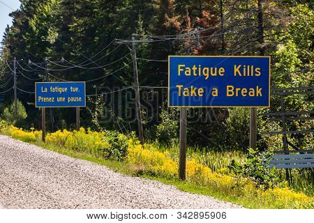 French And English Information Road Blue Signs, Tiredness Kills. Take A Break. Canadian Rural Countr