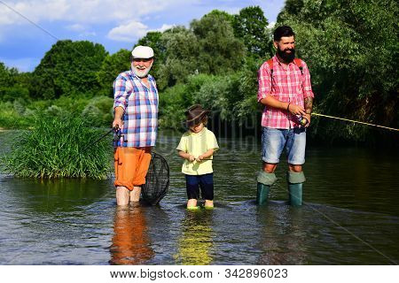 Grandfather, Father And Grandson Fishing Together. Grandson With Father And Grandfather Fishing By L