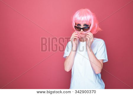 Retro Fashion Concept. Woman With Pink Hair In A Black Glasses And White T-shurt In A Bright Pink St