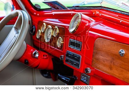 Bright Red Classic Antique Car Dashboard With Wooden And Golden Parts, White Leather Steering Wheel,