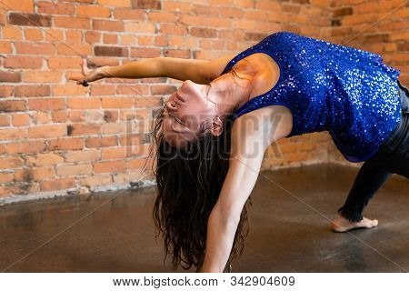A Slim And Flexible Gymnastic Woman Is Seen During An Advanced Vinyasa Flow Yoga Class, In A Crab Po