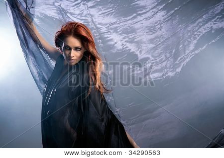 Young attractive woman in blowing silk